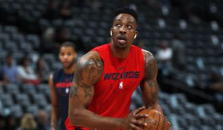 In this March 31, 2019, file photo, injured Washington Wizards center Dwight Howard practices before the Wizards face the Denver Nuggets in an NBA basketball game in Denver. A person familiar with the decision says the Los Angeles Lakers intend to sign Howard after he completes a buyout with Memphis. The person spoke on condition of anonymity Friday, Aug. 23, 2019, because the deal has not been completed for Howard to make an improbable return to the Lakers six years after his acrimonious departure. Howard played in only nine games last season for Washington, which traded him to the Grizzlies last month. (AP Photo/David Zalubowski, File) **FILE**