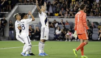 Los Angeles Galaxy's Zlatan Ibrahimovic, center, celebrates with teammates after scoring against Los Angeles FC during the first half of an MLS soccer match Sunday, Aug. 25, 2019, in Los Angeles. (AP Photo/Marcio Jose Sanchez)