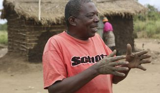 In this photo taken Friday, Aug. 2, 2019, farmer Fernando Amis, explains how Cyclone Idai ruined his home and destroyed his possessions on the outskirts of Gorongosa National Park, Mozambique. When the cyclone roared through central Mozambique in March, it left some 200,000 people homeless and destroyed about 2 million acres of crops. (AP Photo/Tsvangirayi Mukwazhi)