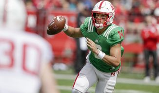 FILE - In this April 13, 2019, file photo, Nebraska red team quarterback Adrian Martinez (2) scrambles during Nebraska's NCAA college football annual red-white spring game, in Lincoln, Neb. No. 24 Nebraska is in the preseason Top 25 for the first time since 2014, and a big reason for the positive vibe is Adrian Martinez. He was the most productive freshman quarterback in the nation, and more is expected this season. (AP Photo/Nati Harnik, File)