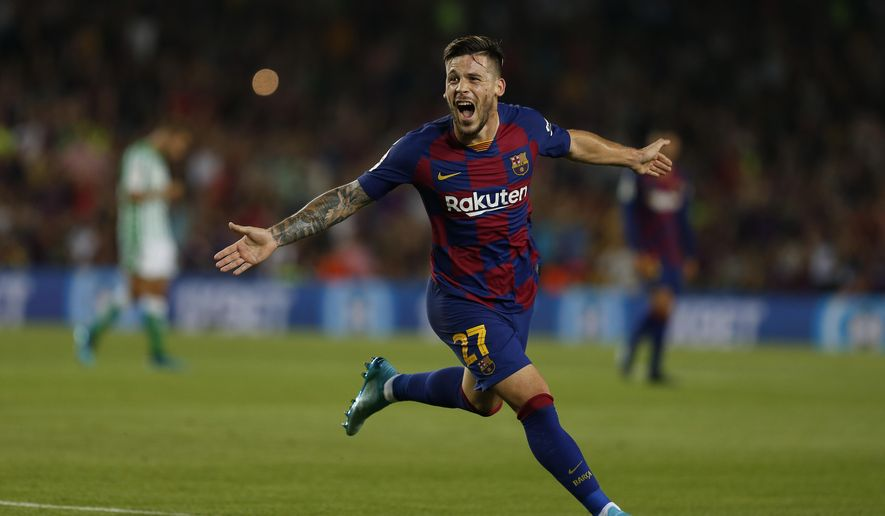 FC Barcelona's Carles Perez celebrates after scoring his side's third goal during the Spanish La Liga soccer match between FC Barcelona and Betis at the Camp Nou stadium in Barcelona, Spain, Sunday, Aug. 25, 2019. (AP Photo/Joan Monfort)