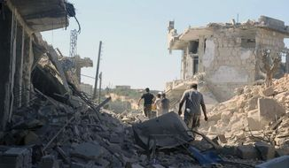 This photo released by the opposition Syrian Civil Defense rescue group, also known as White Helmets, which has been authenticated based on its contents and other AP reporting, shows people inspecting destroyed buildings after airstrikes hit the town of Ihsem, in Idlib province, Syria. Government forces have been on the offensive since April 30, during which they have captured all rebel-held areas in the adjoining Hama province. (Syrian Civil Defense White Helmets via AP)