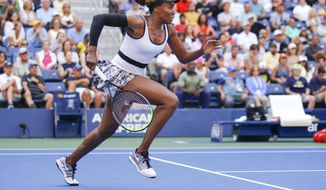 Venus Williams, of the United States, chases down a shot from Zheng Saisai, of China, during the first round of the US Open tennis tournament Monday, Aug. 26, 2019, in New York. (AP Photo/Eduardo Munoz Alvarez)