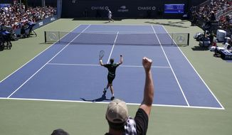 Jenson Brooksby, of the United States, foreground, reacts after defeating Tomas Berdych, of the Czech Republic, during the first round of the US Open tennis tournament Monday, Aug. 26, 2019, in New York. (AP Photo/Michael)