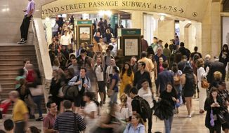 In this Aug. 23, 2019, photo, people pass through New York's Grand Central Terminal. With just a few months left before America starts taking its biggest-ever self-portrait, the U.S. Census Bureau is grappling with a host of concerns about the headcount, including how to ensure that it is secure and accurate and the challenge of getting most people to answer questions online. (AP Photo/Richard Drew)