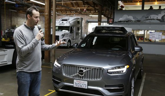 In this Dec. 13, 2016, file photo, Anthony Levandowski, head of Uber's self-driving program, speaks about their driverless car in San Francisco. The former Google engineer is being charged with stealing closely guarded secrets that he later sold to Uber as the ride-hailing service scrambled to catch up in the high-stakes race to build robotic vehicles. The indictment filed Tuesday, Aug. 27, 2019, by the U.S. Attorney's office in San Jose, California, is an offshoot of a lawsuit filed in 2017 by Waymo, a self-driving car pioneer spun off from Google. (AP Photo/Eric Risberg, File)