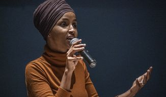 U.S. Rep. Ilhan Omar speaks at a town hall in South Minneapolis on ICE and the administration's immigration detention policies, at the Colin Powell Center in Minneapolis on Tuesday, Aug. 27, 2019. (Richard Tsong-Taatarii/Star Tribune via AP)
