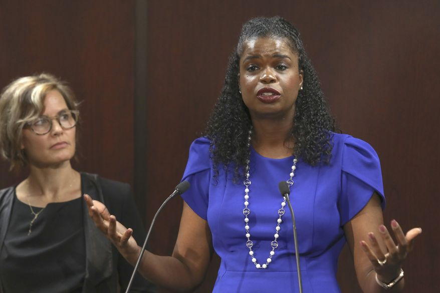 Cook County State's Attorney Kim Foxx speaks at a news conference Tuesday, Aug. 27, 2019, in Chicago accompanied by Jennifer Pahlka, Code for America Founder and Executive Director. Foxx has enlisted Code for America a national nonprofit organization to help clear tens of thousands of marijuana convictions in preparation for legalized recreational use of the drug. Code for America will process the records at no cost to taxpayers through its program called Clear My Record. (AP Photo/Teresa Crawford)