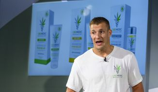 Former New England Patriots tight end Rob Gronkowski holds a news conference announcing his advocacy for CBD and becoming an investor in Abacus Health Products, the maker of CBDMEDIC, Tuesday, Aug. 27, 2019, in New York. (AP Photo/Corey Sipkin)