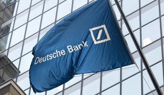 In this Oct. 7, 2016, file photo a flag for Deutsche Bank flies outside the German bank's New York offices on Wall Street. Deutsche Bank revealed in court papers on Tuesday, Aug. 27, 2019, that it has tax records Congress is seeking in its investigation into President Trump's finances. (AP Photo/Mark Lennihan, File)