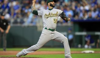 Oakland Athletics starting pitcher Mike Fiers delivers to a Kansas City Royals batter during the first inning of a baseball game at Kauffman Stadium in Kansas City, Mo., Tuesday, Aug. 27, 2019. (AP Photo/Orlin Wagner)