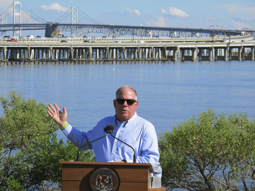 In this Tuesday, Aug. 30, 2016, file photo, Gov. Larry Hogan speaks at a news conference near Annapolis, Md., with the Chesapeake Bay Bridge in the backdrop. In an announcement Tuesday, Aug. 27, 2019, Maryland transportation officials said they have narrowed the possibilities for a new crossing over the Chesapeake Bay to three areas near the current Bay Bridge. (AP Photo/Brian Witte, File)  **FILE**