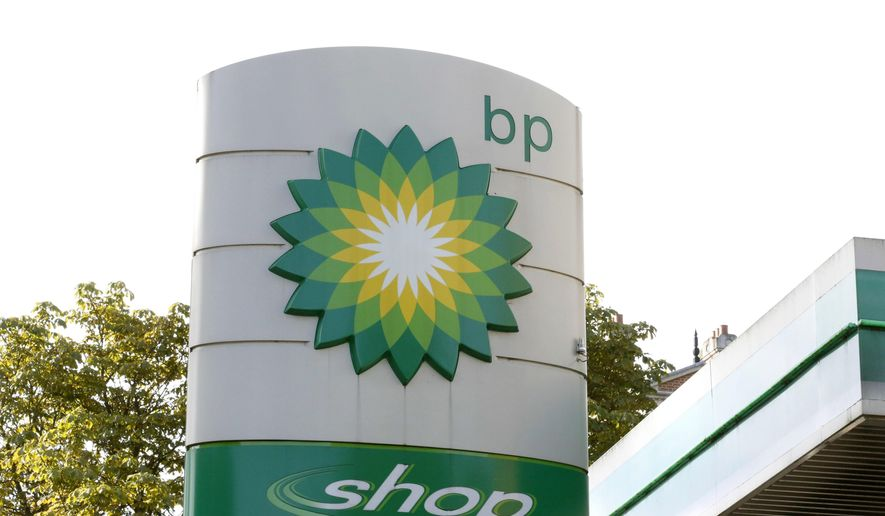 This Aug. 1, 2017, file photo shows the oil producer BP company logo at a petrol station in London. BP, a major player on Alaska's North Slope for decades, is selling all of its Alaska assets, the company announced Tuesday, Aug. 27, 2019. Hilcorp Alaska is purchasing BP interests in both the Prudhoe Bay oil field and the trans-Alaska pipeline for $5.6 billion, BP announced in a release. (AP Photo/Caroline Spiezio, File)
