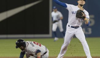 Toronto Blue Jays' Cavan Biggio throws to first after forcing out Atlanta Braves' Billy Hamilton during the third inning of a baseball game Tuesday, Aug. 27, 2019, in Toronto. Ronald Acuña Jr. was safe at first. (Fred Thornhill/The Canadian Press via AP)