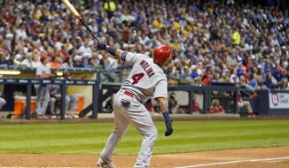 St. Louis Cardinals' Yadier Molina hits a two-run home run during the seventh inning of a baseball game against the Milwaukee Brewers Tuesday, Aug. 27, 2019, in Milwaukee. (AP Photo/Morry Gash)