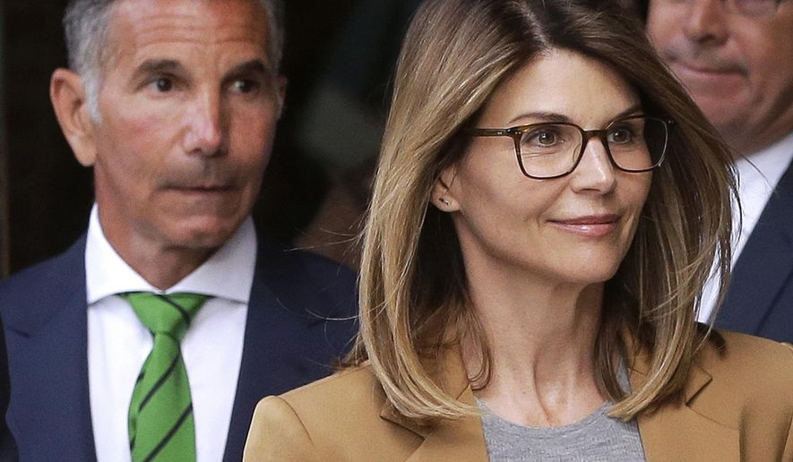 In this April 3, 2019, file photo, actress Lori Loughlin, front, and husband, clothing designer Mossimo Giannulli, left, leave federal court in Boston after facing charges in a nationwide college admissions bribery scandal. Loughlin and Giannulli are scheduled for a hearing in the bribery scam case on Tuesday, Aug. 27 in Boston. (AP Photo/Steven Senne, File)