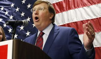 Lt. Gov. Tate Reeves celebrates before supporters after being declared winner of the runoff for the Republican nomination for governor in Jackson, Miss., Tuesday evening, Aug. 27, 2019. Reeves beat former Mississippi Supreme Court Chief Justice Bill Waller Jr., in the runoff. (AP Photo/Rogelio V. Solis)