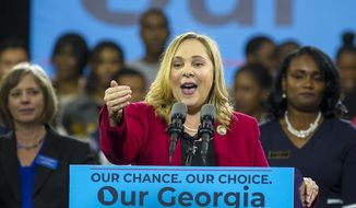 FILE - In a Friday, Nov. 2, 2018 file photo, Sarah Riggs Amico speaks during a rally for Democratic gubernatorial candidate Stacey Abrams, at Morehouse College in Atlanta. Business executive and 2018 candidate for lieutenant governor Sarah Riggs Amico announced her candidacy for the U.S. Senate Tuesday, August 27, 2019.  (Alyssa Pointer/Atlanta Journal-Constitution via AP, File)