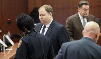 Ronald Haskell, center, appears in Judge George Powell's courtroom for his capital murder trial in the 2014 massacre of a Spring family Tuesday, Aug. 27, 2019, in Houston. Haskell  traveled from California to suburban Houston in 2014 and stalked his ex-wife's family for two days before killing six of them as part of his plan to harm anyone who had helped his former spouse, a Texas prosecutor told jurors Monday.(Steve Gonzales/Houston Chronicle via AP)