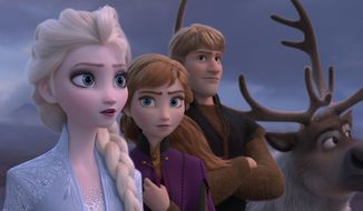 """This image released by Disney shows Elsa, voiced by Idina Menzel, from left, Anna, voiced by Kristen Bell, and Kristoff, voiced by Jonathan Groff in a scene from """"Frozen 2,"""" in theaters on Nov. 22. (Disney via AP)"""