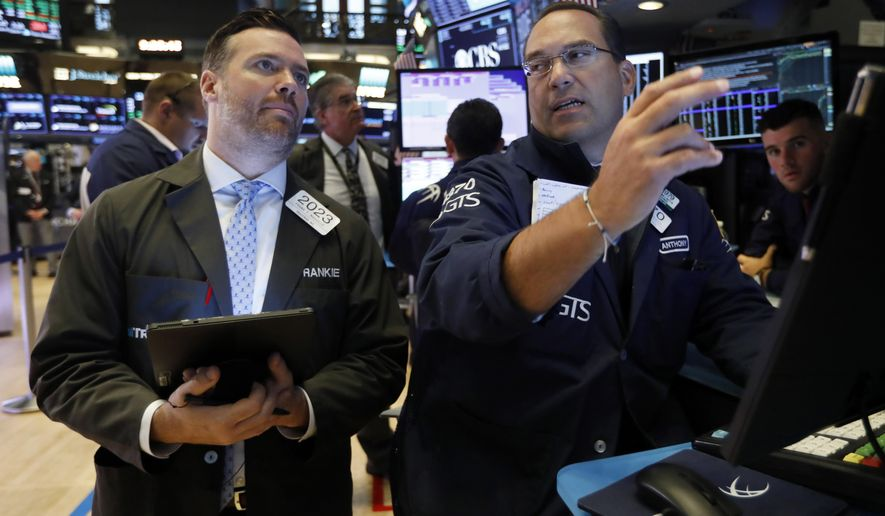 FILE - In this Aug. 19, 2019, file photo trader Frank Masiello, left, and specialist Anthony Matesic work on the floor of the New York Stock Exchange. The U.S. stock market opens at 9:30 a.m. EDT on Tuesday, Aug. 27. (AP Photo/Richard Drew, File)