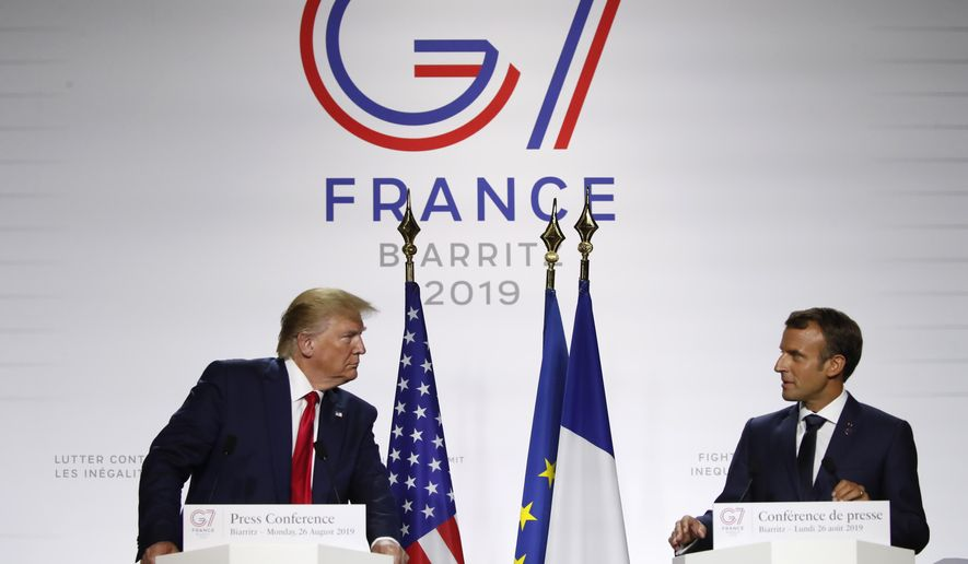 French President Emmanuel Macron and U.S President Donald Trump attend the final press conference during the G-7 summit Monday, Aug. 26, 2019, in Biarritz, southwestern France. (AP Photo/Francois Mori)