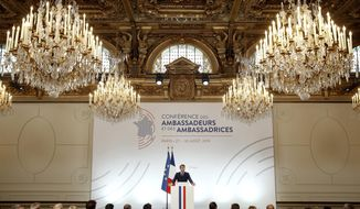 """French President Emmanuel Macron delivers a speech during the annual French ambassadors conference at the Elysee Palace in Paris, Tuesday, Aug. 27 2019. French President Emmanuel Macron is calling for a new global economic order, decrying an """"unprecedented crisis"""" in the market economy. (Yoan Valat, Pool via AP)"""