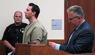 FILE - In this June 5, 2019 file photo former critical care doctor William Husel, center, pleads not guilty to murder charges while appearing with defense attorney Richard Blake, right, in Franklin County Court in Columbus, Ohio. The Ohio hospital system that found Husel ordered excessive painkillers for about three dozen patients who died has reached settlements totaling $9 million in lawsuits over two deaths. Those are much larger than previous settlements in cases involving the Columbus-area Mount Carmel Health System and fired doctor William Husel.(AP Photo/Kantele Franko, File)