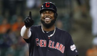 Cleveland Indians' Franmil Reyes gestures tot the dugout after hitting a double in the sixth inning of a baseball game against the Detroit Tigers in Detroit, Tuesday, Aug. 27, 2019. (AP Photo/Paul Sancya)