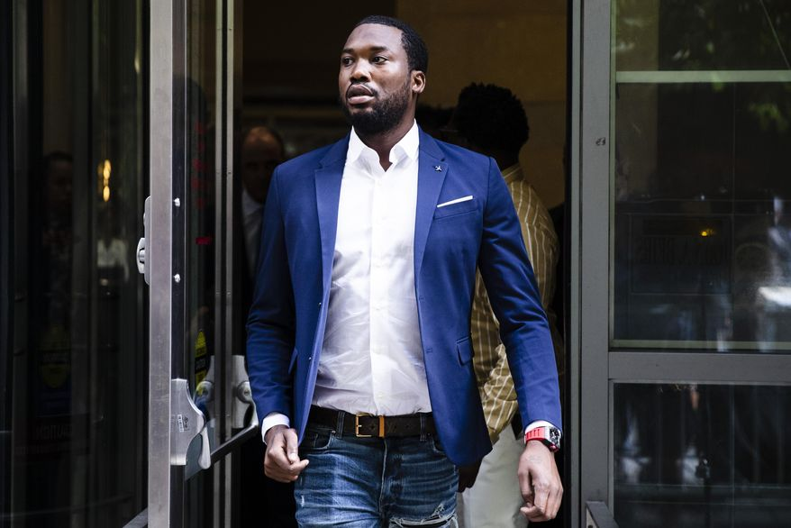 In this Aug. 6, 2019, file photo, rapper Meek Mill departs from the criminal justice center in Philadelphia after a status hearing. (AP Photo/Matt Rourke, File)
