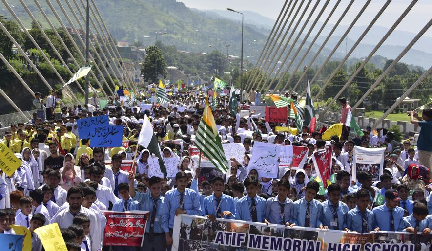 Pakistani students rally to express solidarity with Indian Kashmiris, in Muzaffarabad, capital of Pakistani Kashmir, Tuesday, Aug. 27, 2019. Students denounced India's downgrading of the special status of the portion of the disputed region it controls. (AP Photo/M.D. Mughal)