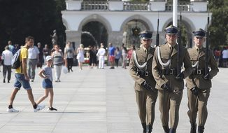 Polish soldiers take part in a changing of the guard at the Tomb of the Unknown Soldier at Pilsudski Square in Warsaw, Poland, Tuesday, Aug. 27, 2019. The square will be the site of commemorations Sunday marking the 80th anniversary of the start of World War II, to be attended by over 40 world leaders, including President Donald Trump.(AP Photo/Czarek Sokolowski)
