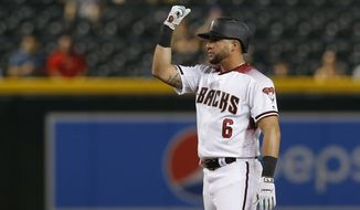 Arizona Diamondbacks' David Peralta reacts after hitting a double against the Colorado Rockies in the seventh inning during a baseball game, Monday, Aug. 19, 2019, in Phoenix. (AP Photo/Rick Scuteri)