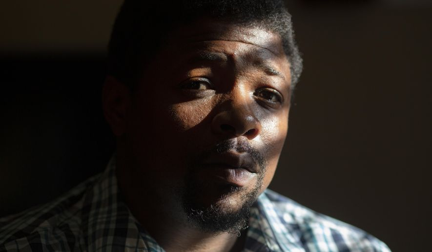 La Jarvis D. Love is photographed in his home in Senatobia, Miss., Sunday, June 9, 2019. Love says he was sexually abused by a Franciscan friar at a Catholic grade school in Greenwood. (AP Photo/Wong Maye-E)