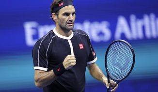 Roger Federer pumps his fist after defeating Sumit Nagal during the first round of the U.S. Open tennis tournament in New York, Monday, Aug. 26, 2019. Federer won 4-6, 6-1, 6-1, 6-4. (AP Photo/Charles Krupa)
