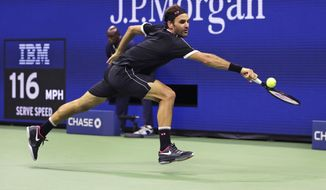 Roger Federer stretches for a return against Sumit Nagal during the first round of the U.S. Open tennis tournament in New York, Monday, Aug. 26, 2019. (AP Photo/Charles Krupa)