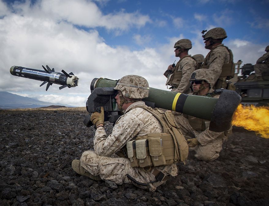 "FGM-148 JAVELIN FIRE AND FORGET ANTI-TANK MISSILE - A U.S. Marine attached to Weapons Company, 1st Battalion, 3rd Marine Regiment - ""The Lava Dogs"" fires a Javelin at a simulated enemy tank during Lava Viper aboard Pohakuloa Training Area, Hawaii, May 29, 2015. Marines of Weapons Company train and conduct anti-armor procedures while at Lava Viper. (U.S. Marine Corps photo by Cpl. Ricky S. Gomez/Released)"