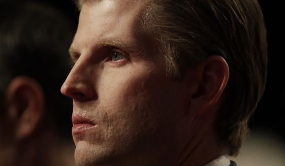 Eric Trump listens to opening remarks before the vice-presidential debate between Republican vice-presidential nominee Gov. Mike Pence and Democratic vice-presidential nominee Sen. Tim Kaine at Longwood University in Farmville, Va., Tuesday, Oct. 4, 2016.  (AP Photo/Patrick Semansky)