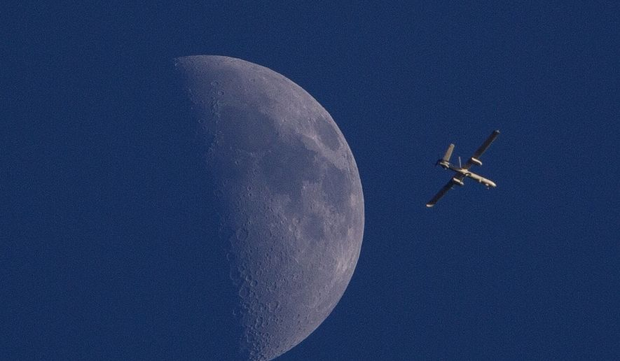 An Israeli drone circles over Gaza City on Sunday, Aug. 3, 2014. (AP Photo/Dusan Vranic)