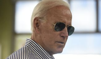 Democratic presidential candidate former Vice President Joe Biden pays for his order at a Krispy Kreme following a campaign town hall on Wednesday, Aug. 28, 2019, in Spartanburg, S.C. (AP Photo/Meg Kinnard)