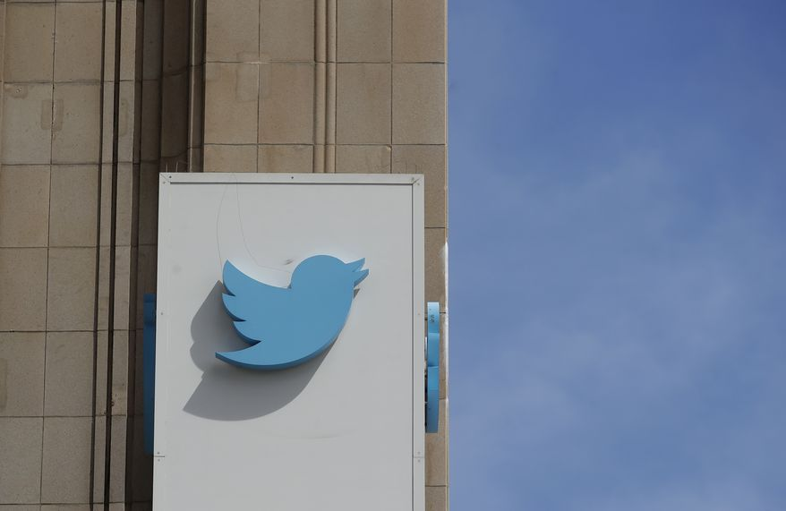 This July 9, 2019, file photo shows a sign outside of the Twitter office building in San Francisco. Social media platforms are facing intense, often contradictory demands from Washington to oversee internet content without infringing on First Amendment rights. (AP Photo/Jeff Chiu, File)