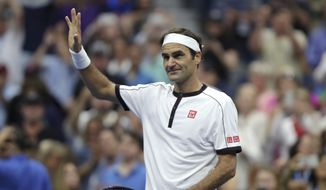 Roger Federer, of Switzerland, reacts after defeating Damir Dzumhur, of Bosnia, during the second round of the US Open tennis championships Wednesday, Aug. 28, 2019, in New York. (AP Photo/Eduardo Munoz Alvarez)
