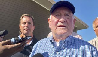 U.S. Agriculture Secretary Sonny Perdue speaks to reporters at an Ag Policy Summit during a visit Wednesday, Aug. 28, 2019, to Decatur, Ill. Perdue has sought to assuage farmers' fears of financial problems after China halted purchases of U.S. farm products in an escalating trade war. (AP Photo/John O'Connor)