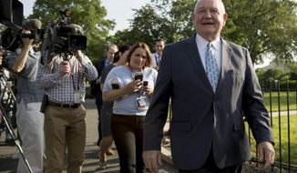 FILE - In this May 23, 2019 file photo, Agriculture Secretary Sonny Perdue laughs with a reporter on the North Lawn of the White House in Washington. U.S. Agriculture Secretary Sonny Perdue will visit Illinois Wednesday, AUG. 28, 2019, amid rising tensions between farmers and President Donald Trump's administration. (AP Photo/Andrew Harnik File)