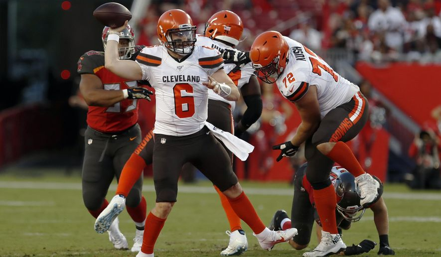 FILE - In this Friday, Aug. 23, 2019 file photo, Cleveland Browns quarterback Baker Mayfield (6) throws a pass against the Tampa Bay Buccaneers during the first half of an NFL preseason football game in Tampa, Fla. Baker Mayfield has a new teammate, and she rocks a headband too. The Browns' charismatic quarterback has entered a marketing partnership with Progressive and will star alongside his wife, Emily Wilkinson, in a national advertising campaign for the insurance giant in which the couple plays homeowners inside a football stadium.  (AP Photo/Mark LoMoglio, File)