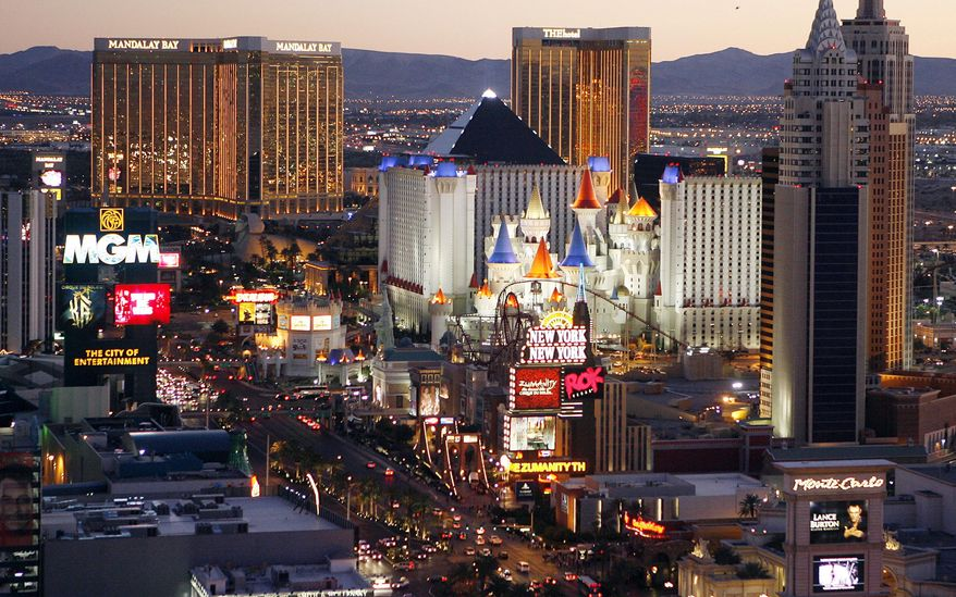 """FILE - This Oct. 20, 2009 file photo shows casinos on the Las Vegas Strip. July was good for casinos in Nevada, where state regulators say house winnings topped $1 billion for the fourth time in seven months this year. The Nevada Gaming Control Board reported Wednesday, Aug. 28, 2019 that the statewide """"gaming win"""" in July was up 2.9% compared with the same month in 2018. (AP Photo/Isaac Brekken, File)"""