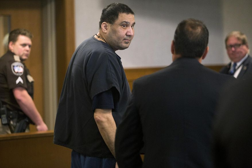 Julio Carrillo looks back at his attorney, Derrick X. Banda, as the court goes into recess during his sentencing hearing Wednesday, Aug. 28, 2019, in Belfast, Maine. Carrillo was sentenced to 55 years in prison for the beating death of his 10-year-old stepdaughter, a crime that led to changes in the state welfare system. (Brianna Soukup/Portland Press Herald via AP)