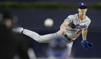 Los Angeles Dodgers starting pitcher Walker Buehler works against a San Diego Padres batter during the first inning of a baseball game Tuesday, Aug. 27, 2019, in San Diego. (AP Photo/Gregory Bull)