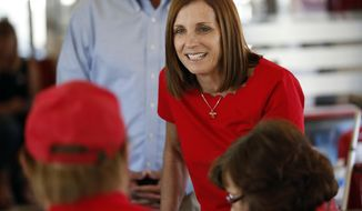 "FILE - In this Nov. 6, 2018 file photo, then-Arizona Republican senatorial candidate Martha McSally speaks with voters at Chase's diner in Chandler, Ariz.  A Phoenix-area businessman says he will challenge McSally in next year's Republican primary. Daniel McCarthy told The Associated Press on Wednesday, Aug. 28, 2019 that Congress needs ""conservative outsiders to step in and push back quickly."" His challenge could pose a serious threat to McSally, who was appointed to finish John McCain's Senate term. (AP Photo/Matt York, File)"