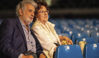 Spanish tenor Placido Domingo and his wife, Marta Domingo sit during the rehearsal of the opening gala of the Gerard Of Sagredo Youth Forum and Sports Center in Szeged, Hungary, Tuesday, August 27, 2019, a day prior to the event. (Tibor Rosta/MTI via AP)